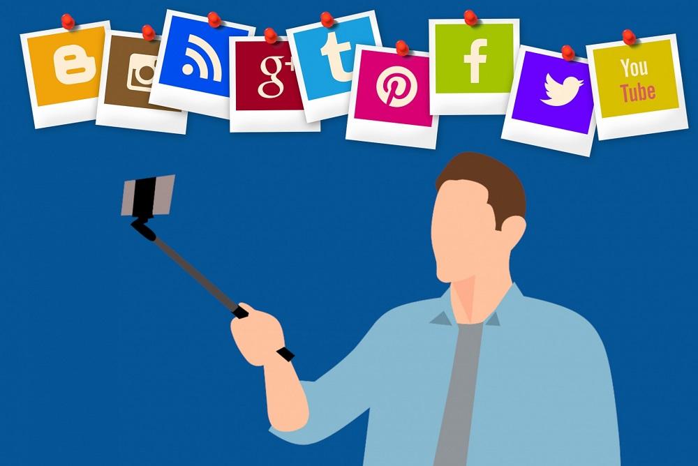 Social media influencer using a selfie stick