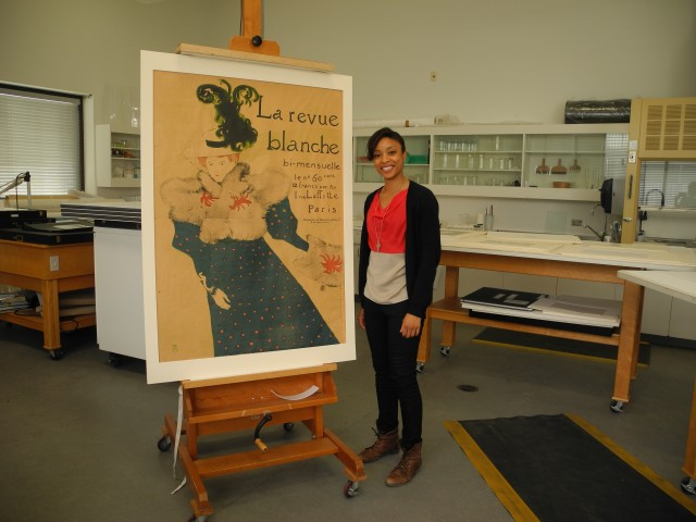 Tessa Thomas and a Toulouse-Lautrec poster.