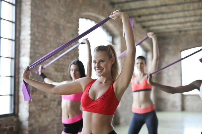 Girls working out in the gym yoga class