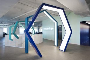 Atop the Complexe de Gaspé in the Mile End neighbourhood sits Ubisoft Montréal's newest workspace. The video game developer's worldwide brand logo is rendered as a set of four illuminated geometric archways over each of the two interior staircases. Photo by Frank Desgagnes