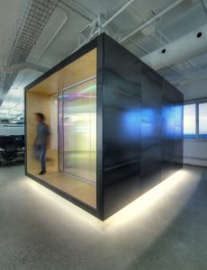 Twinwall polycarbonate partitions brighten private meeting rooms with filtered coloured light. Photo by Frank Desgagnes