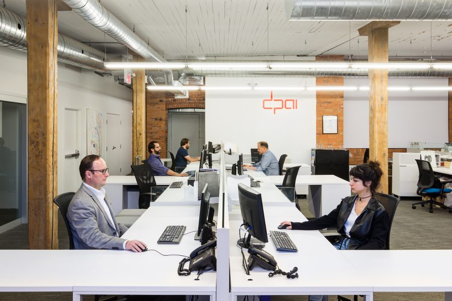 The second floor is home to Hamilton's first coworking space. A modern desk system was organized in four linear banks on the eastern and northern bays of the space. Photo: Revelateur Studio
