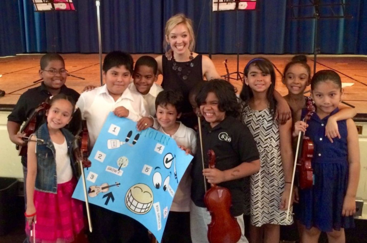 Lauren with violin students after their recital!