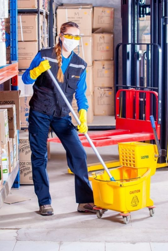 Woman with Mop and Safety Equipment