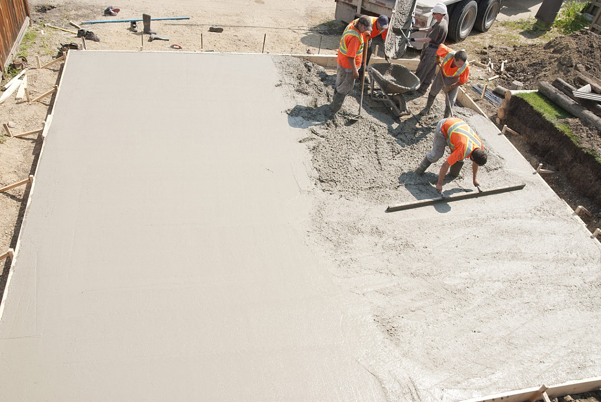 Construction workers applying concrete DuroVac Blog