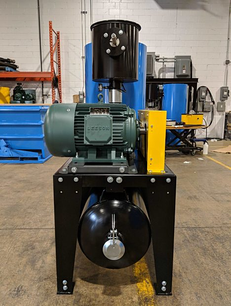 15-30 HP Stationary DVP Industrial Vacuum paired with Elevator PowerLift Series.