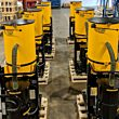 A production lineup of DuroVac's LTS 3 Industrial Vacuum Systems for heavy silica powders.