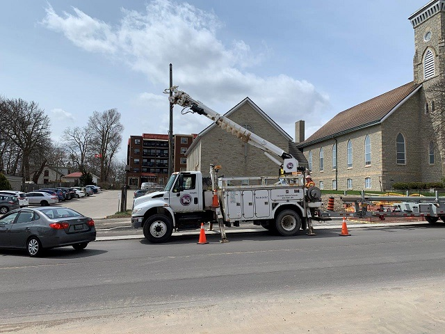 truck removing old streetlight poles