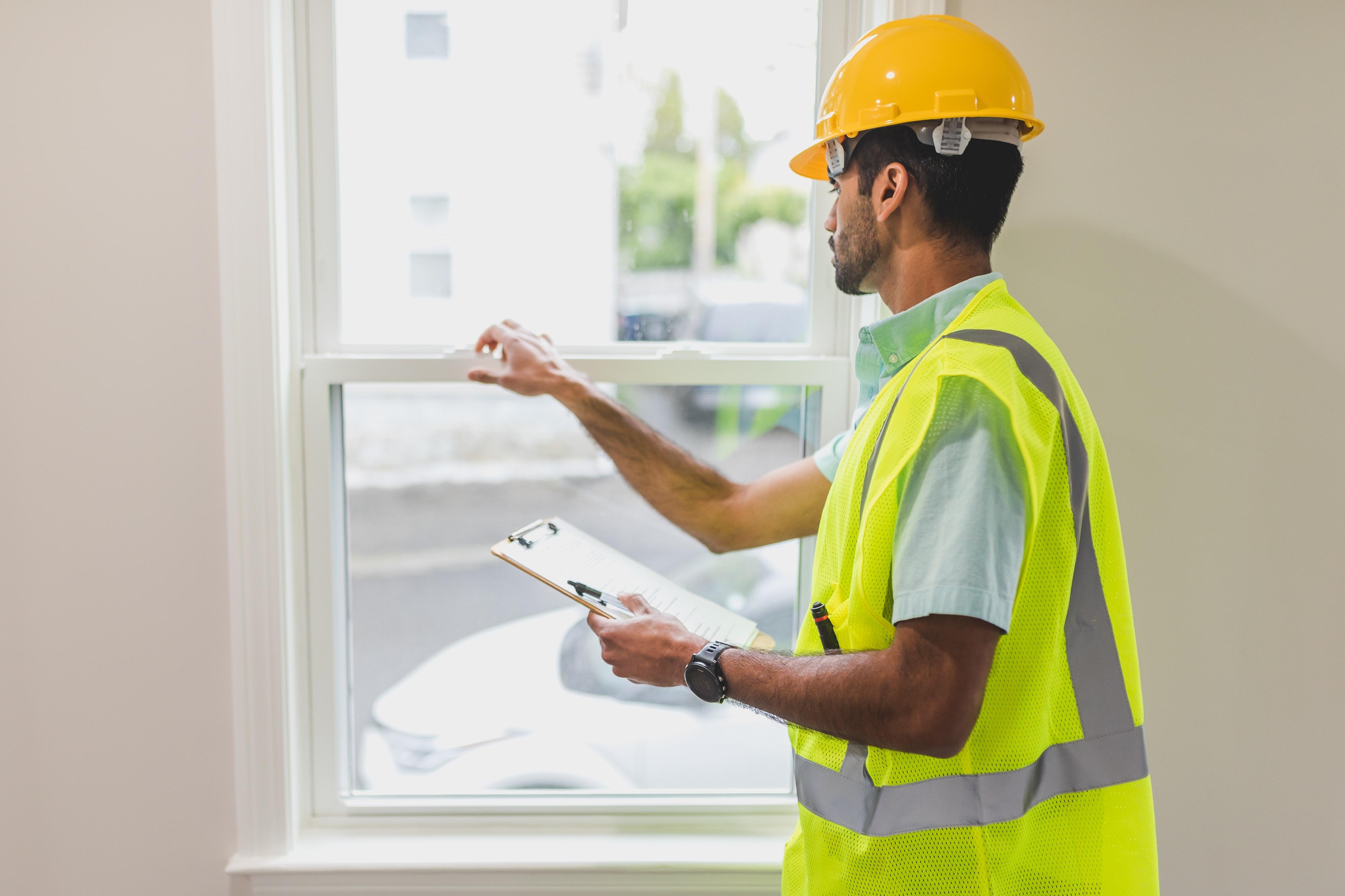 Energy advisor examines window