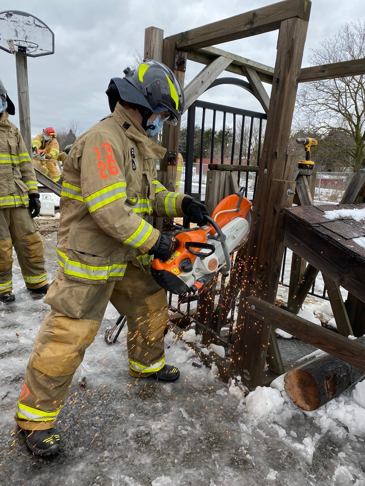 Firefighter cutting icy gate