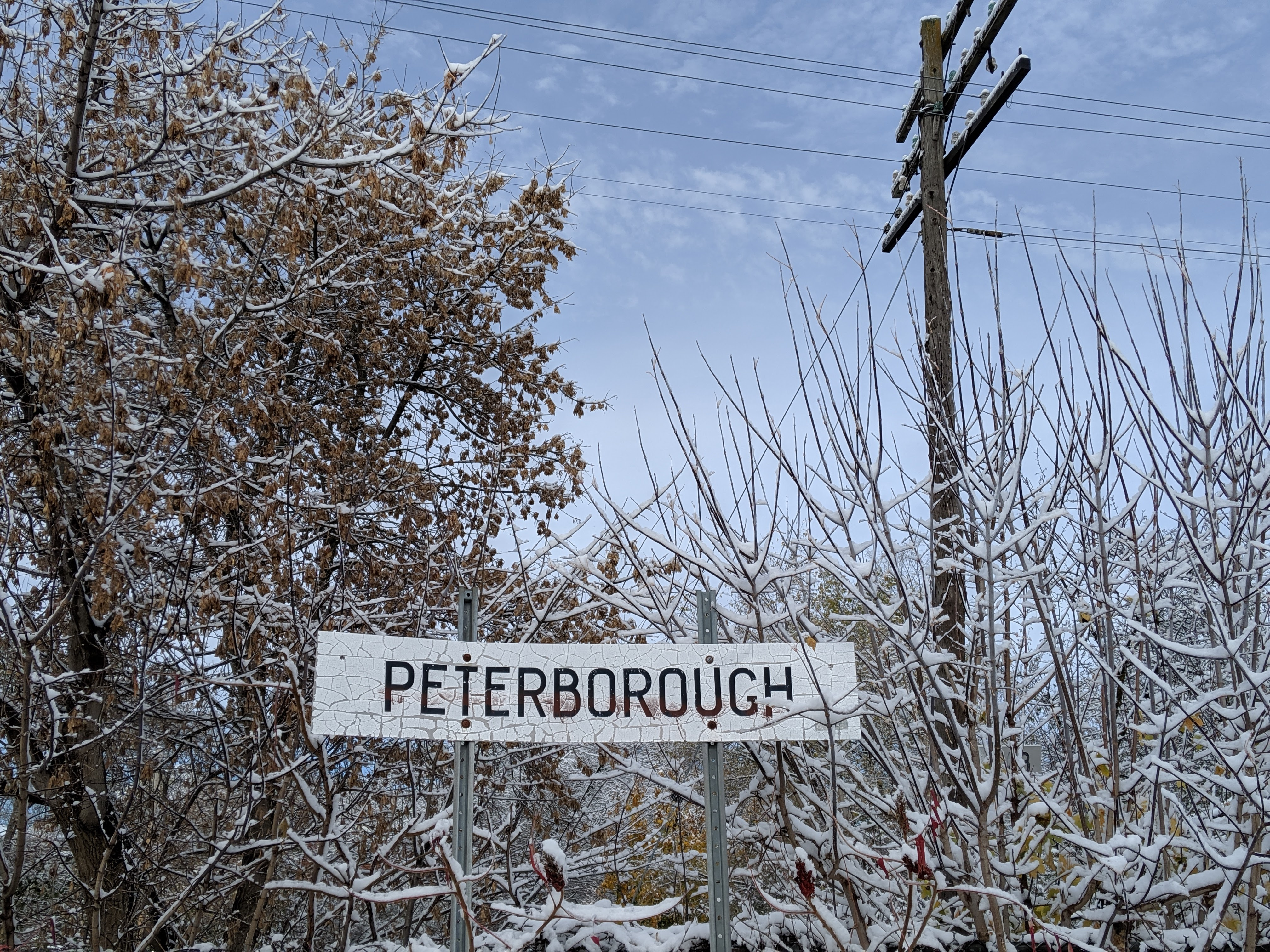 Peterborough city sign covered in snow