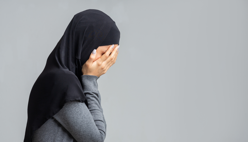 a woman wearing a hijab covering her face