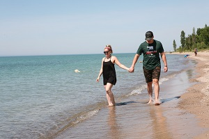 Couple walking on pc beach