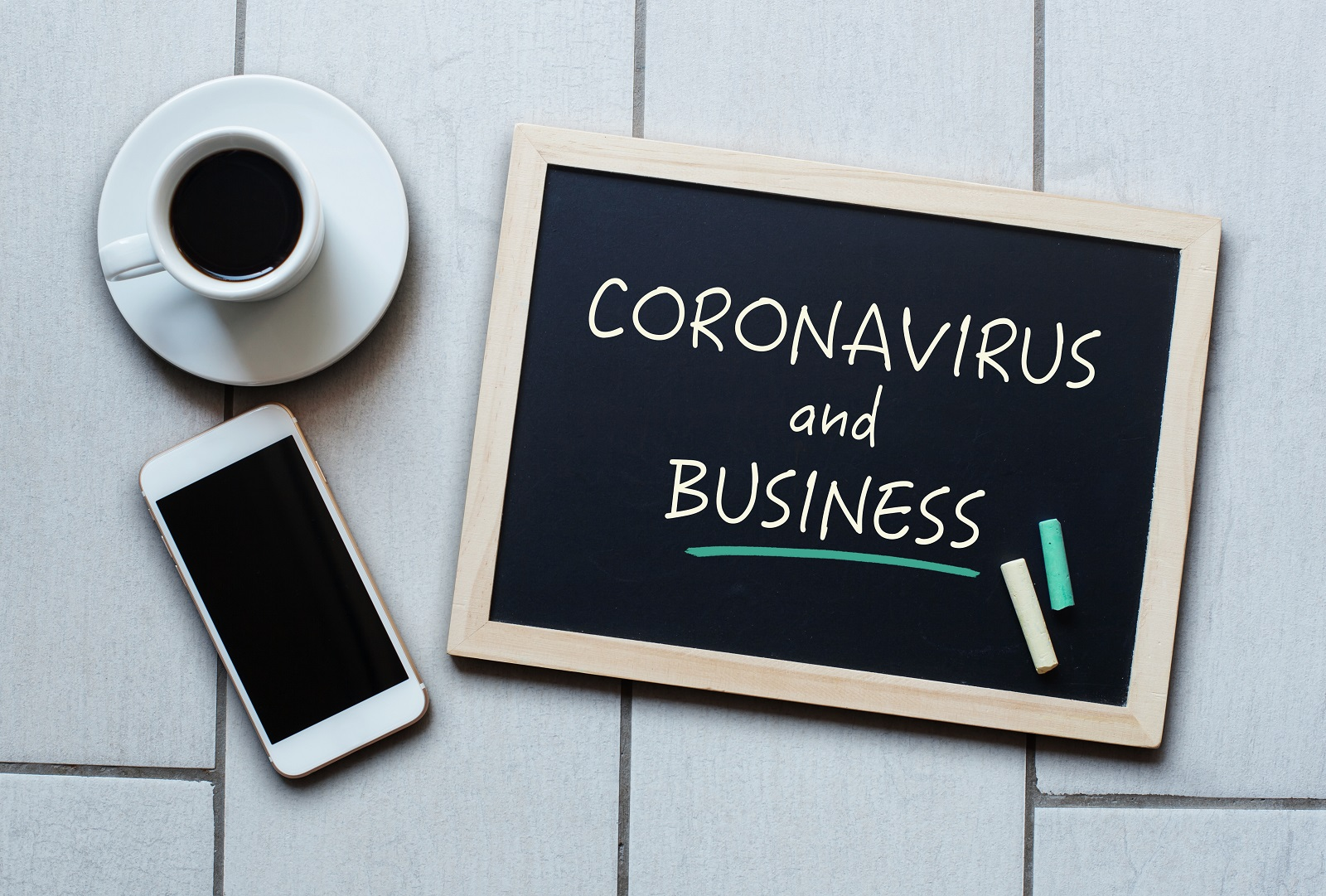 COVID and Business - written on chalkboard
