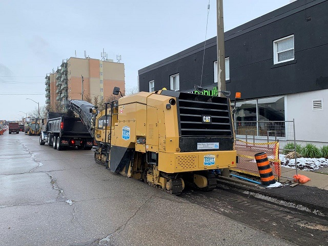 Machine removing road asphalt in Stage 3