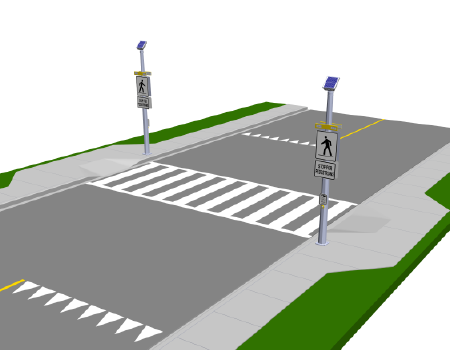 Pictured is a pedestrian crossing and shared pathway. There is a white painted crosswalk with signage and lighting on both sides of the road, indicating that it is a pedestrian crossing.