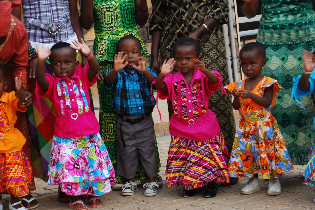 Little girls and boys wave their hands in celebration at the Christmas party
