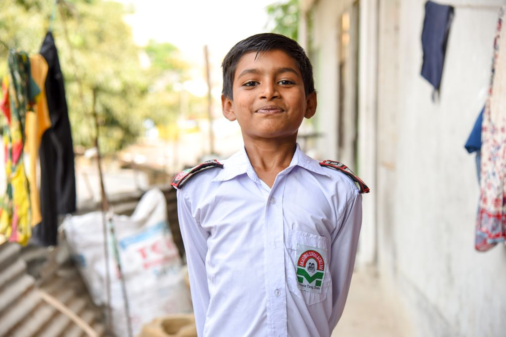 A male child, boy, Pranto is happy to show off his white school uniform, in which he looks his best!