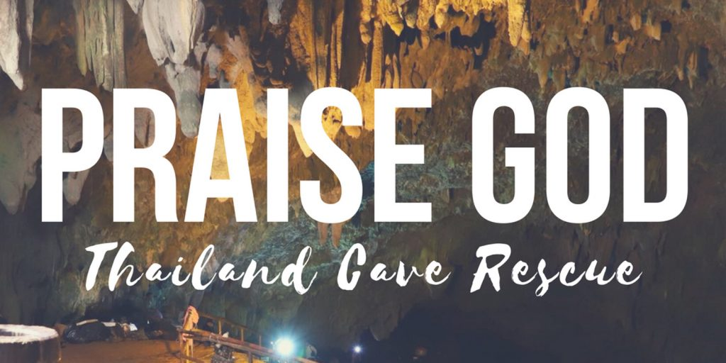 "A picture of the cave in Thailand, with the words ""Praise God."""