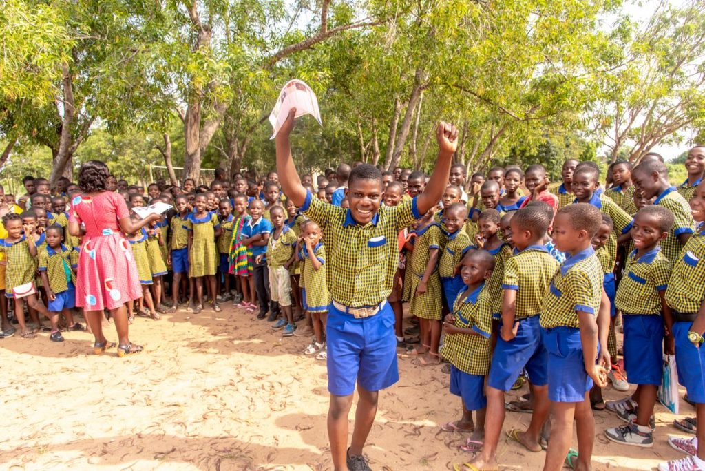 t is the end of the day on Saturday. The children are at an assembly, expecting to receive letters from the sponsors. A few got letters. Godwin is one of the few beneficiaries who receive letters frequently. He is seen here, excited, holding a letter.
