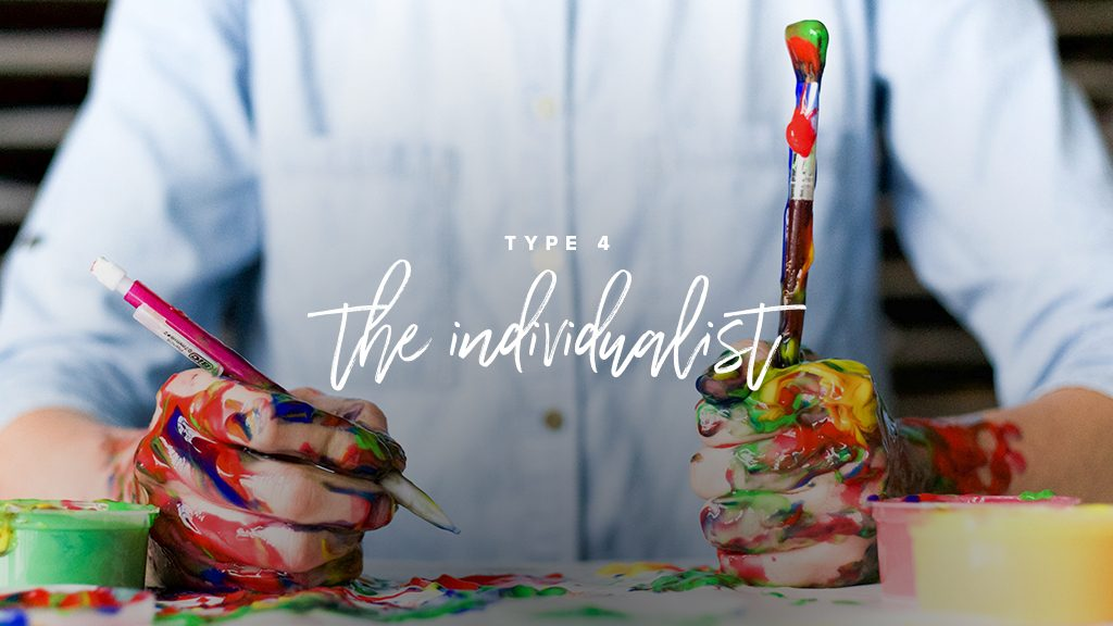 """""""type 4: the individualist"""" a man with a bottom up shirt is holdsa paint brush and a pencil with his hands covered in paint."""