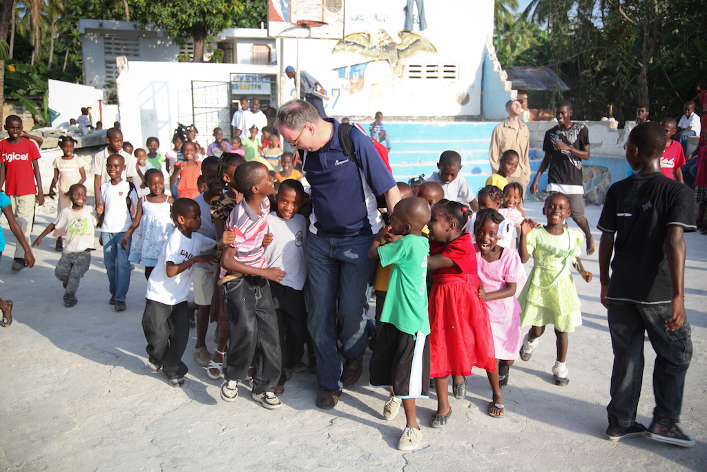 Barry walking amongst a group of children in one of Compassion's field countries.