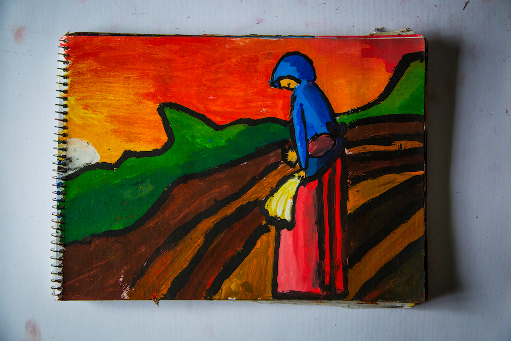 One of Hector's paintings, of a woman standing in an agriculture field.