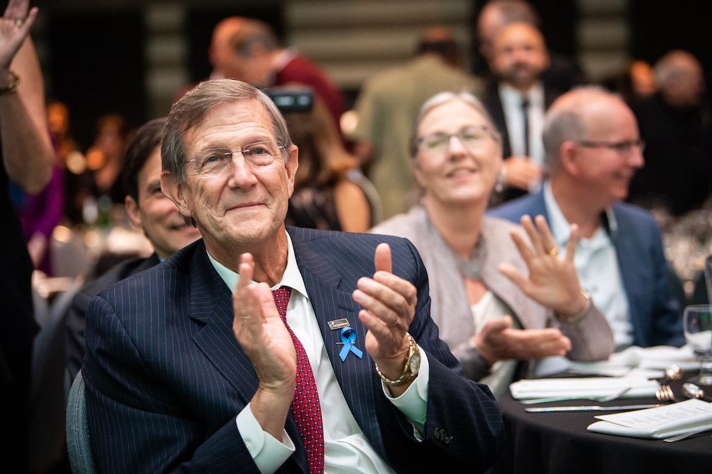 Dr. Wess Stafford offers applause during the event programme.