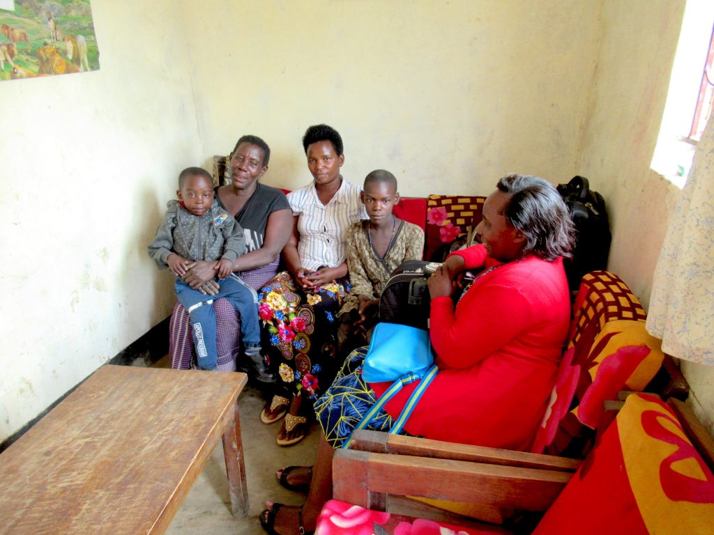 Saviour welcomed back by his family after his surgery.