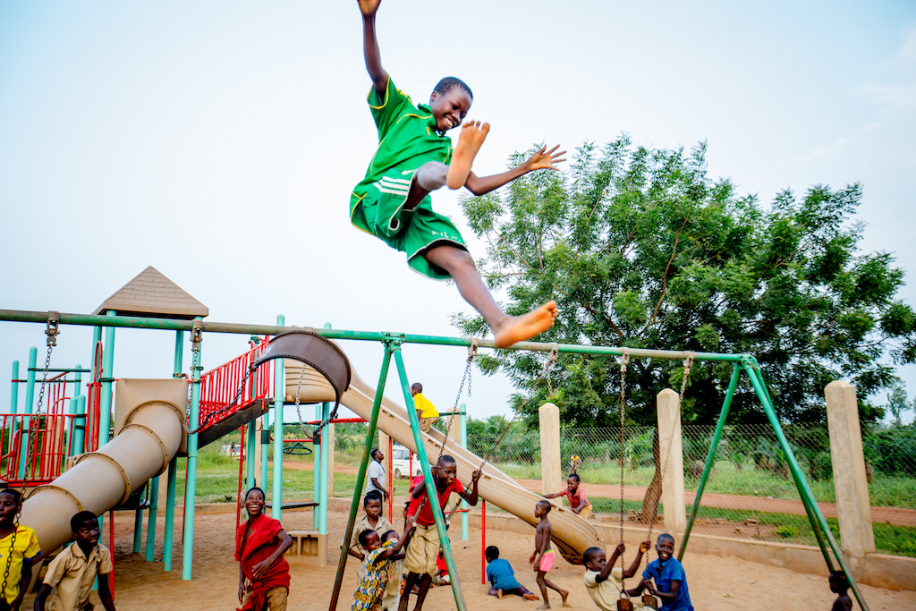 Children playing on a playground in Togo.