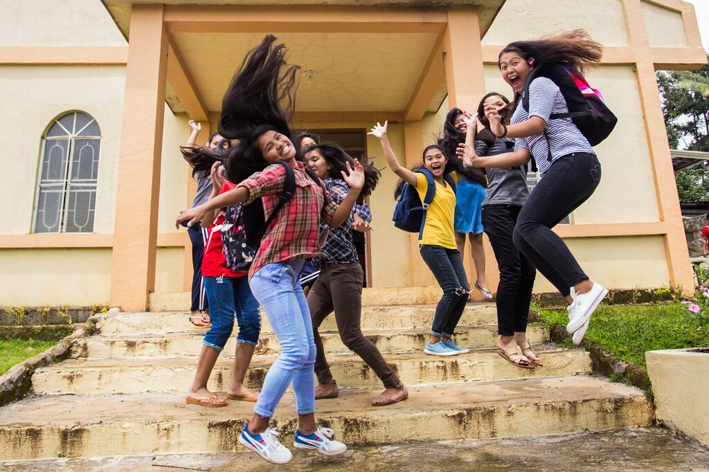 Girls jumping in the air laughing