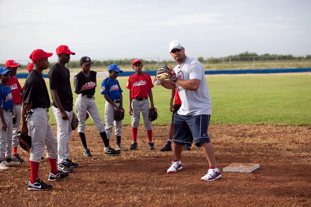 Albert Pujols playing baseball with DR boys