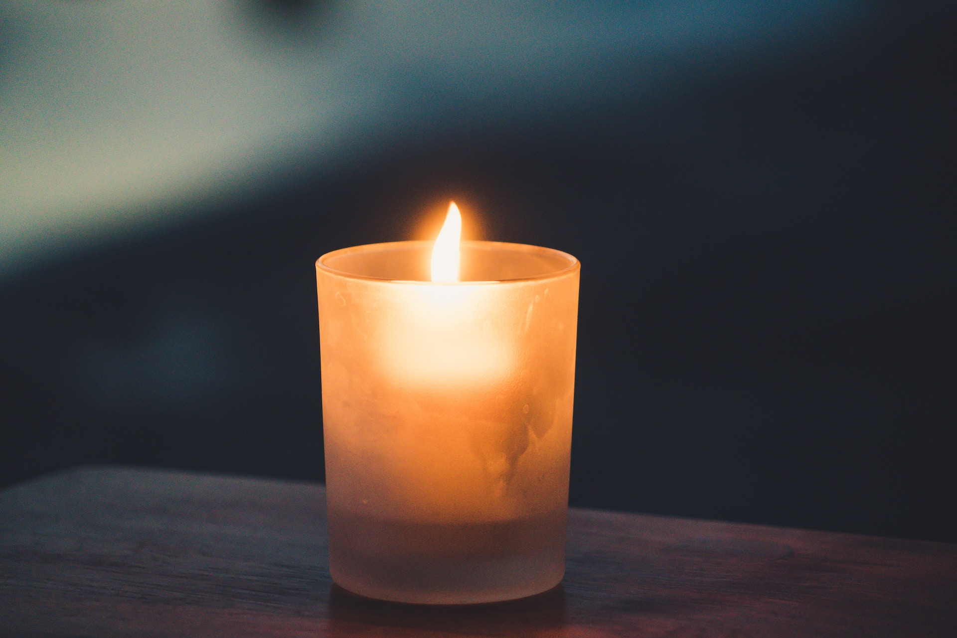 A candle on a table.