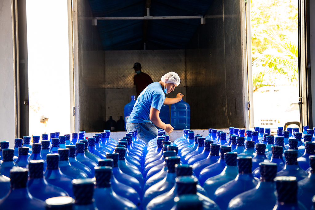 Joel loads a truck with water for delivery to Compassion Centres in the region.