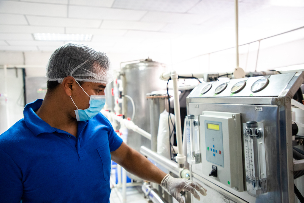 Leonardo, a employee at the water plant, checks the purification system.