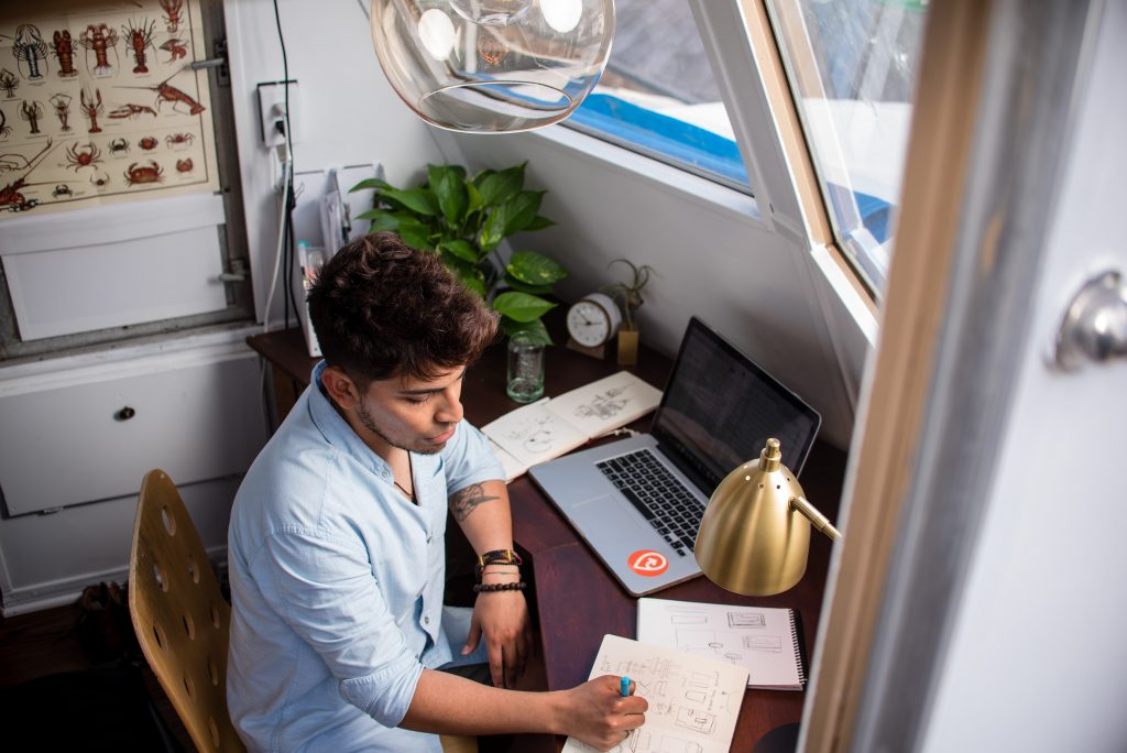 A man sits at his desk, working.