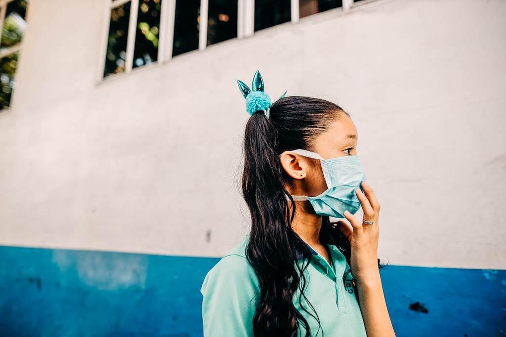 A child wearing a mask.