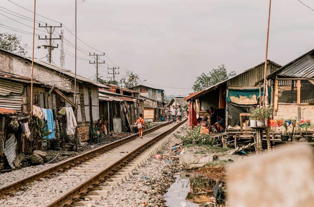 A child walking through a slum community.