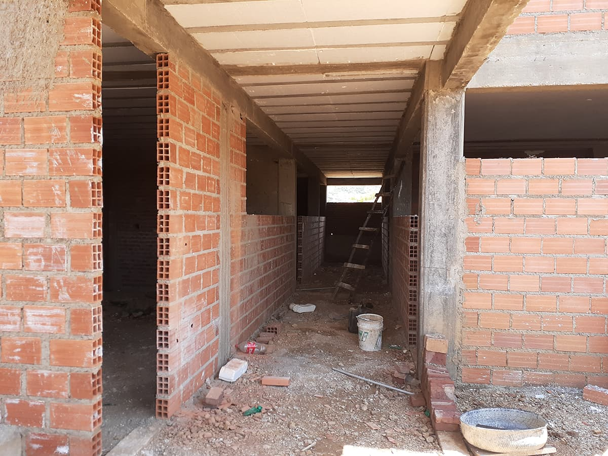 Classroom hallways before plaster was installed.