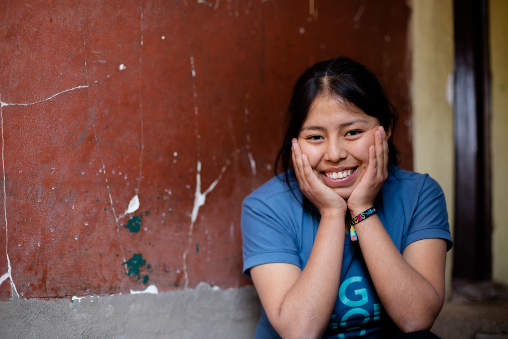A smiling Bolivian teenager.