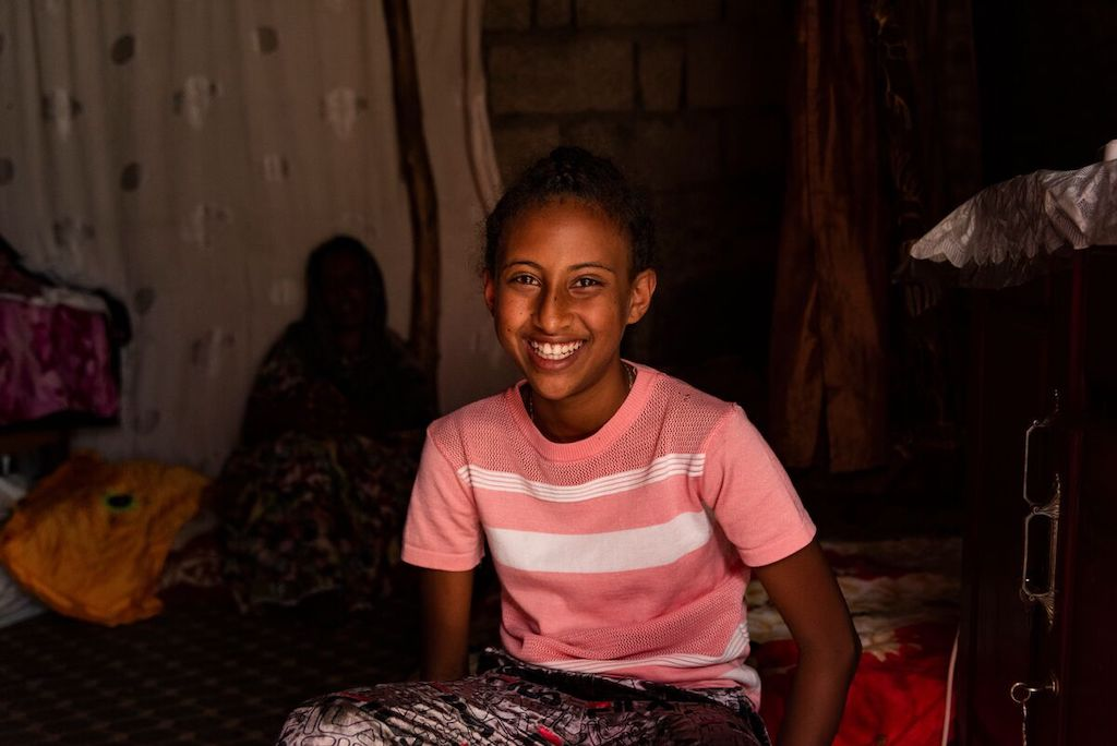 A portrait of Saron, smiling.