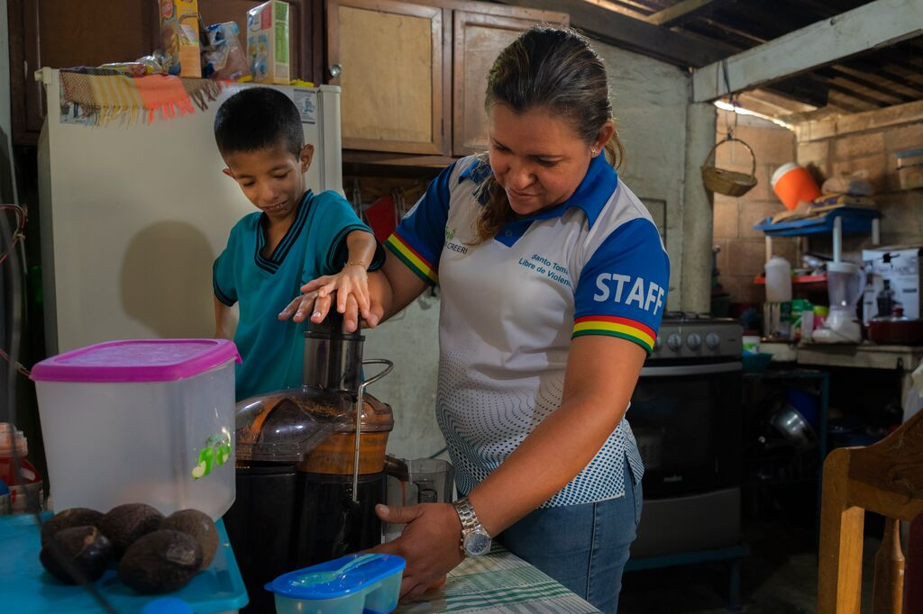 Levi and Dulce Maria make nutrient-rich juice with a juicer bought with a financial gift from Levi's sponsors.