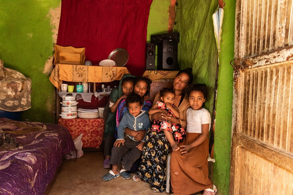 Single mother, Abiyot, in her home with 5 of her 6 children.