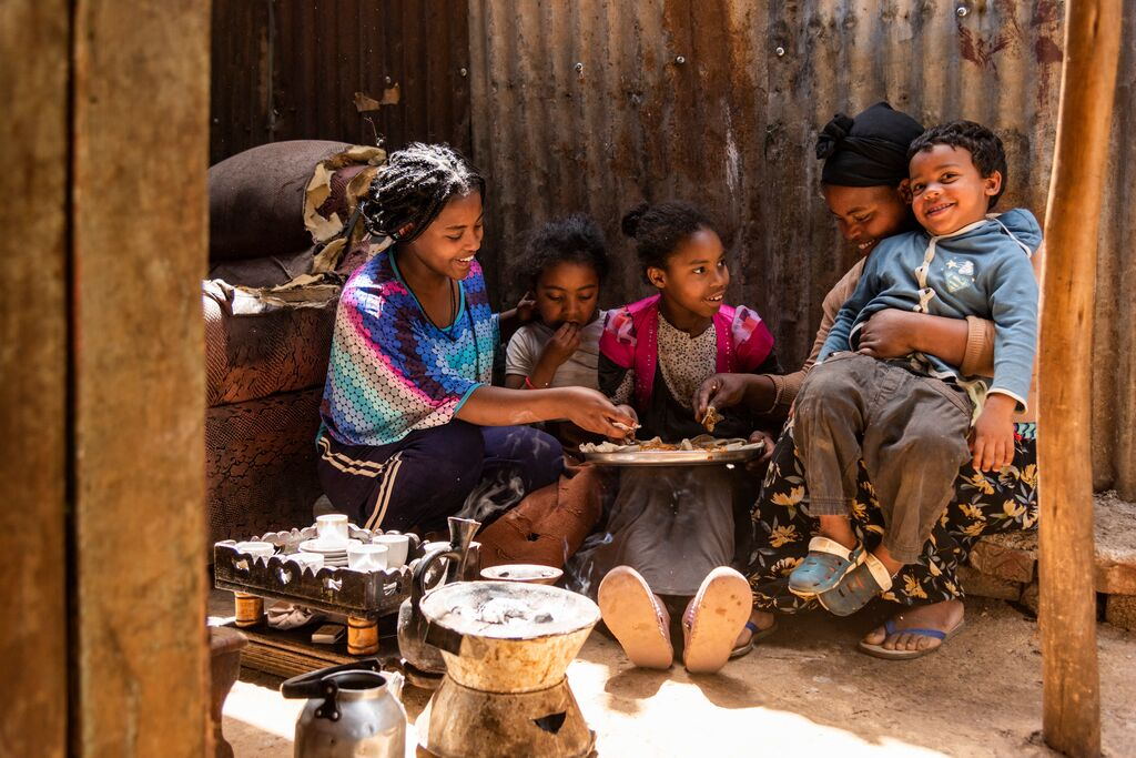 Abiyot's family eats food altogether from the money they received from Compassion.