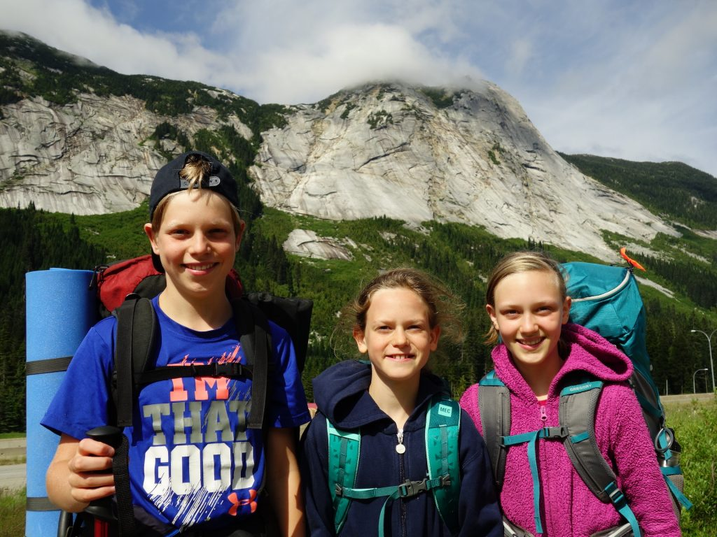 The Hennesey siblings hiking in the mountains—just one of their many family activities. Elias (left), Amadeus (middle) and Eowyn (right).