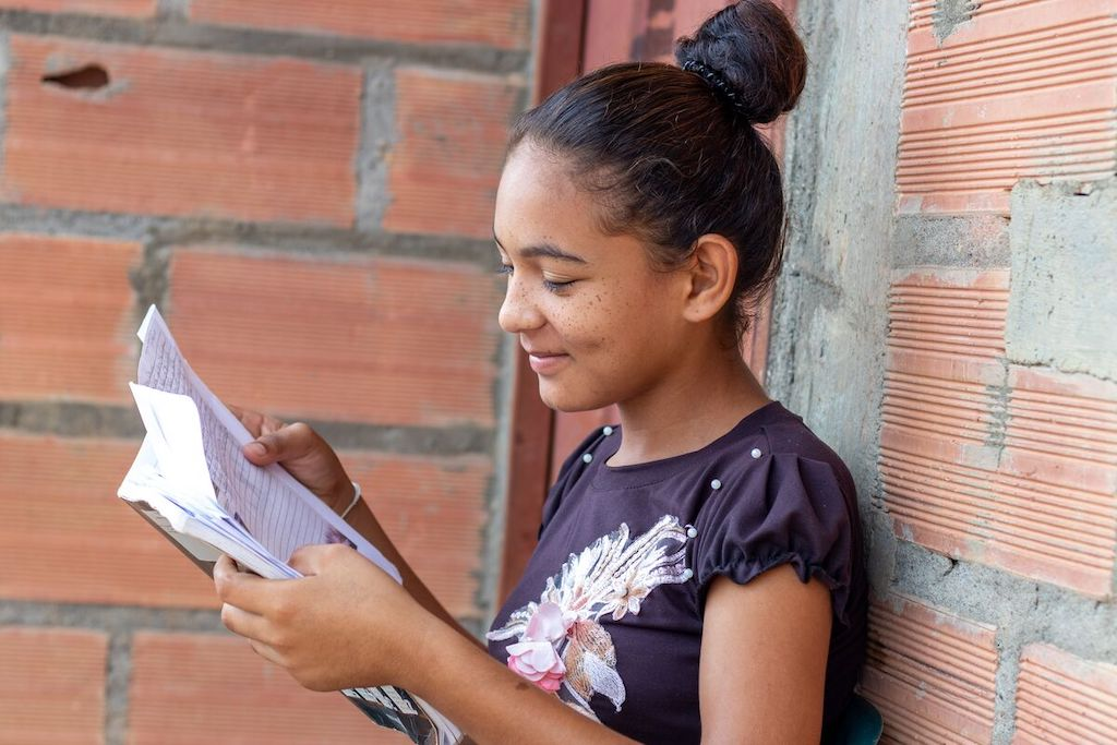 Dayana reads a letter from her sponsor.