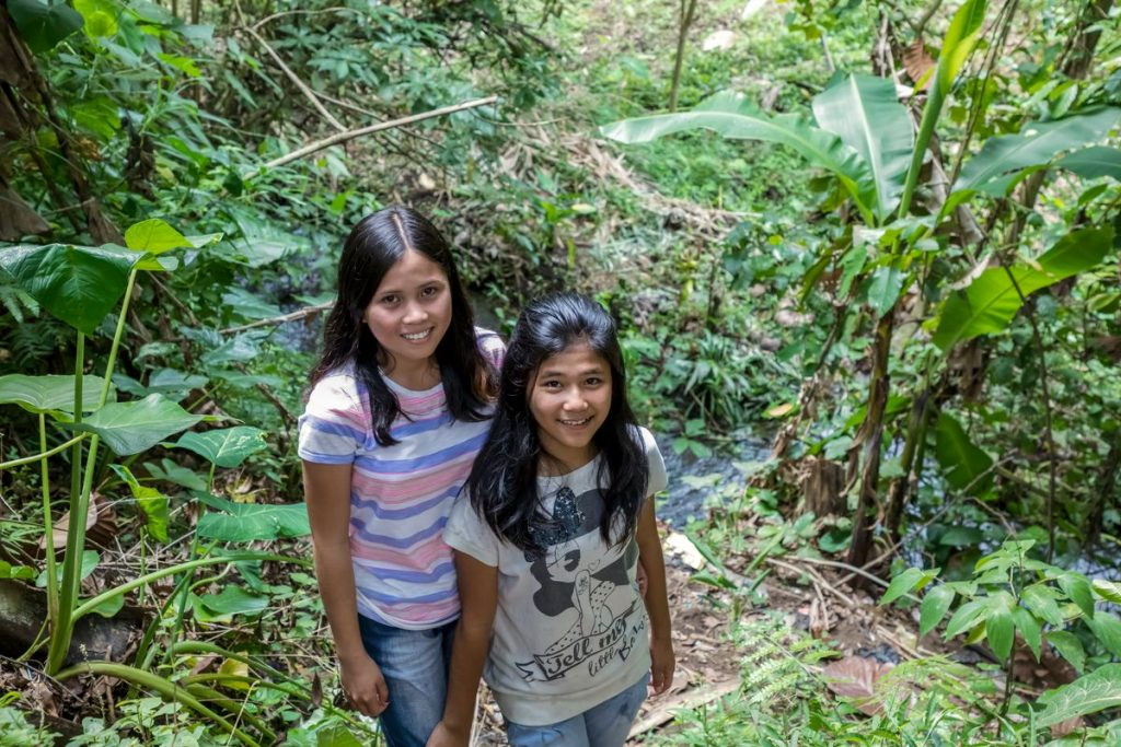 Siska and Anita stand in front of the river