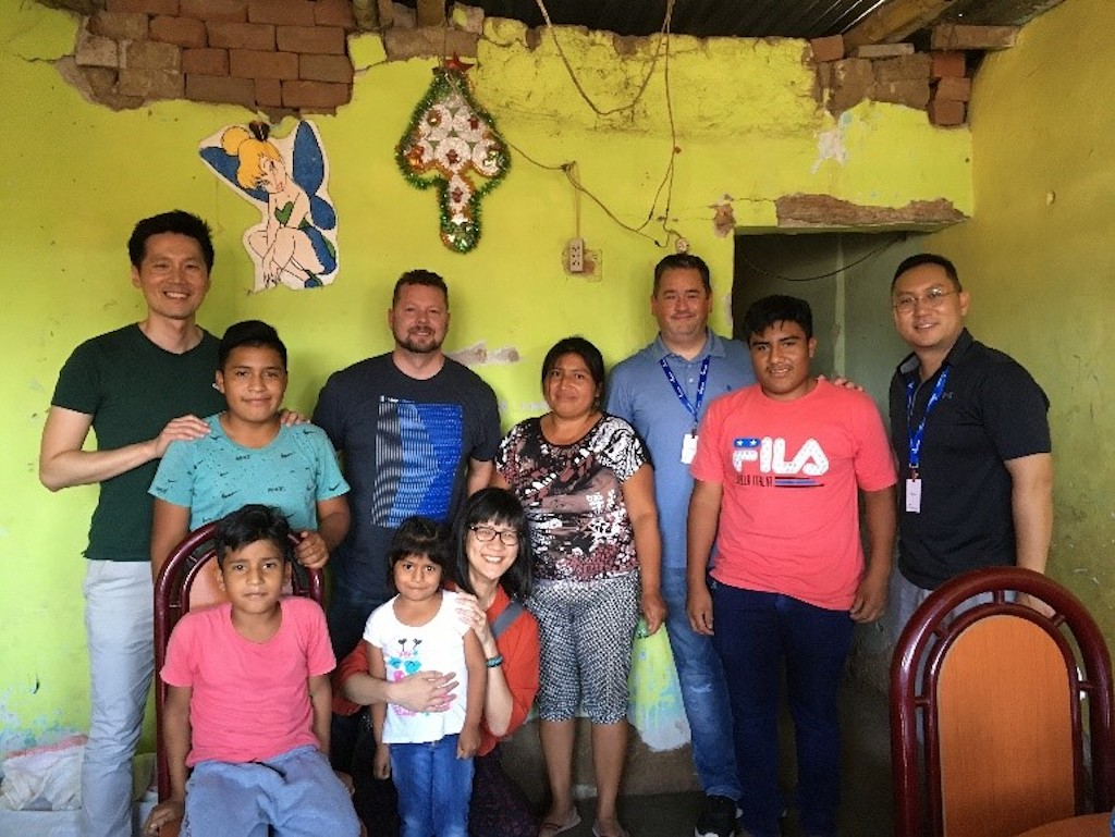 A group of Canadian pastors with a Peruvian family in their home.