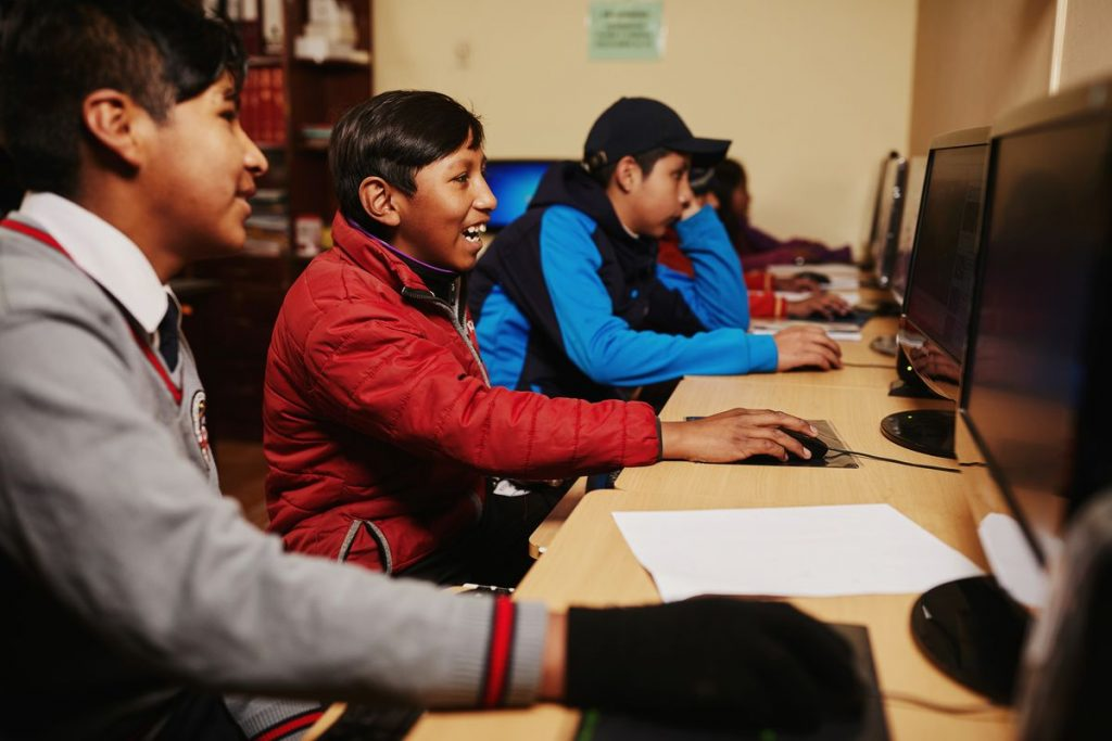 These kids in Compassion's program are learning at their child development centre'snew computer labin Bolivia.