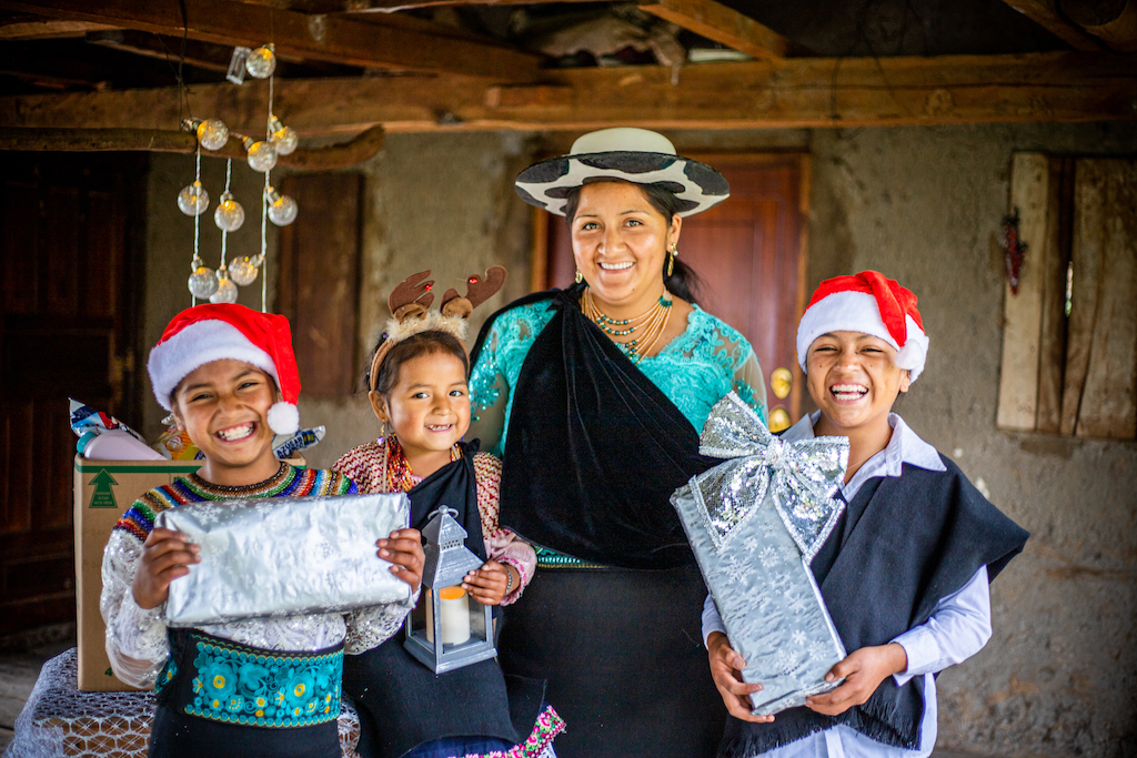 Jenny and all her children are filled with joy and excitement after a special Christmas delivery from their Compassion centre
